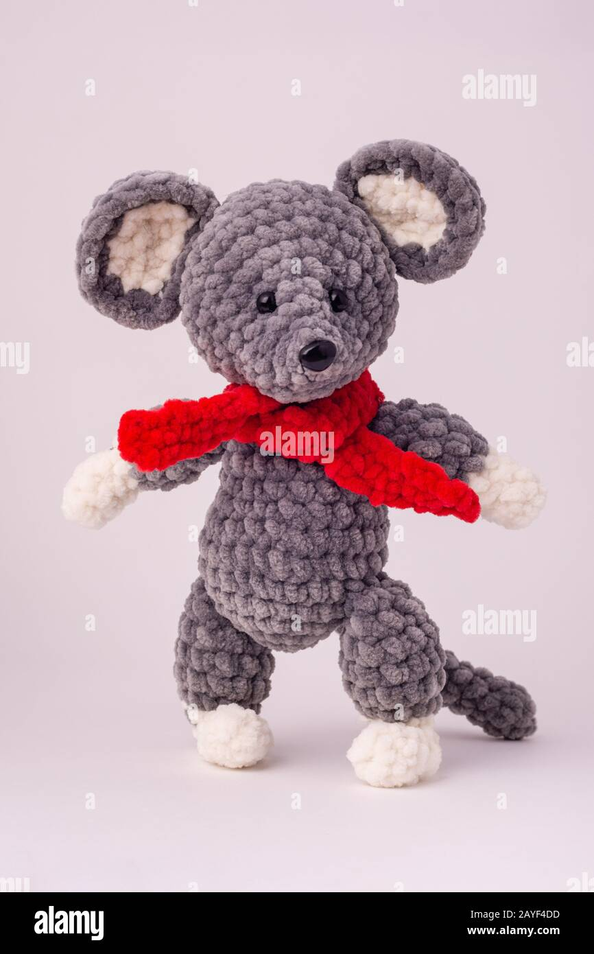 Funny knitted teddy mouse, white background Stock Photo