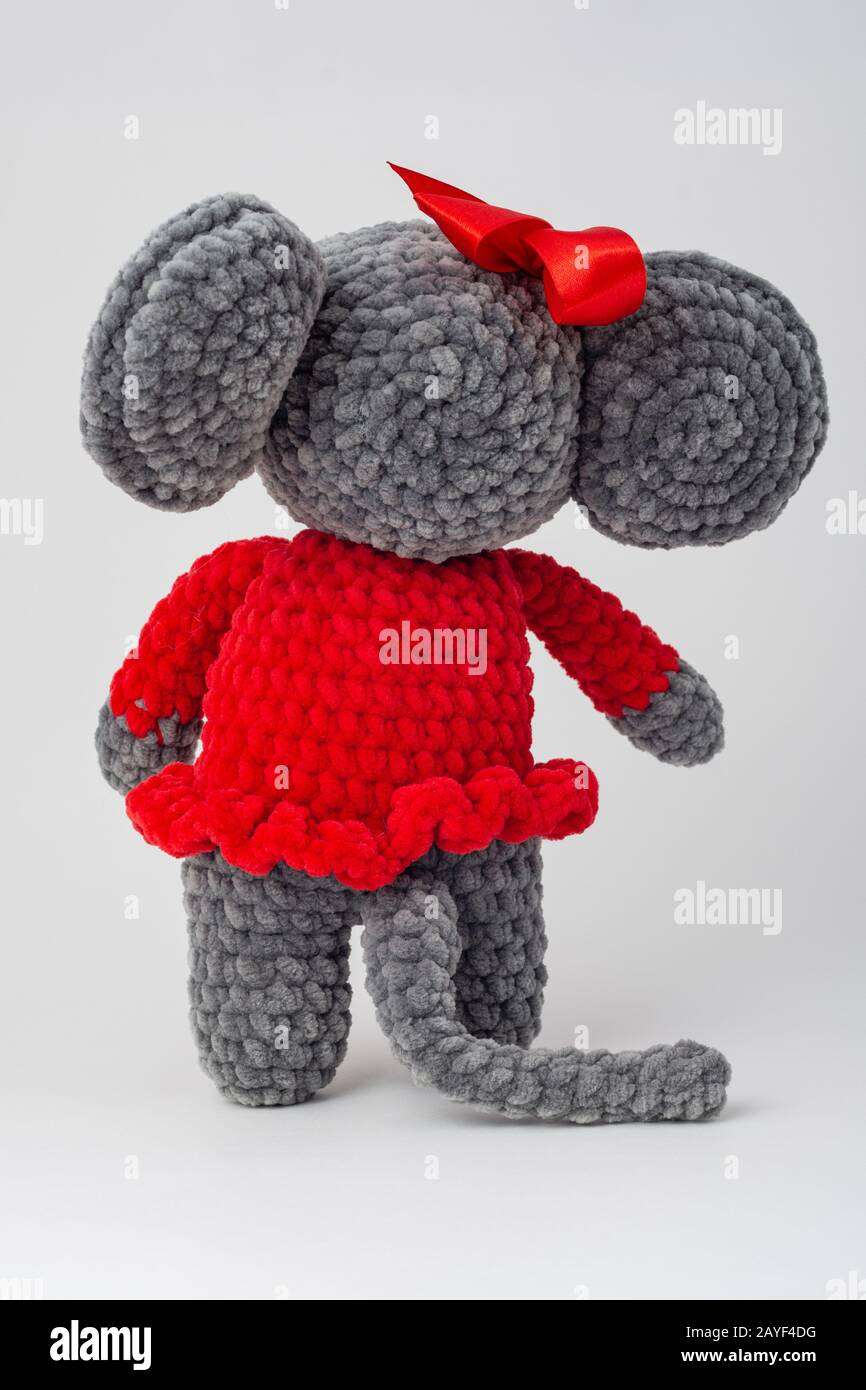 Plush mouse with a red bow on its head, Rear view Stock Photo
