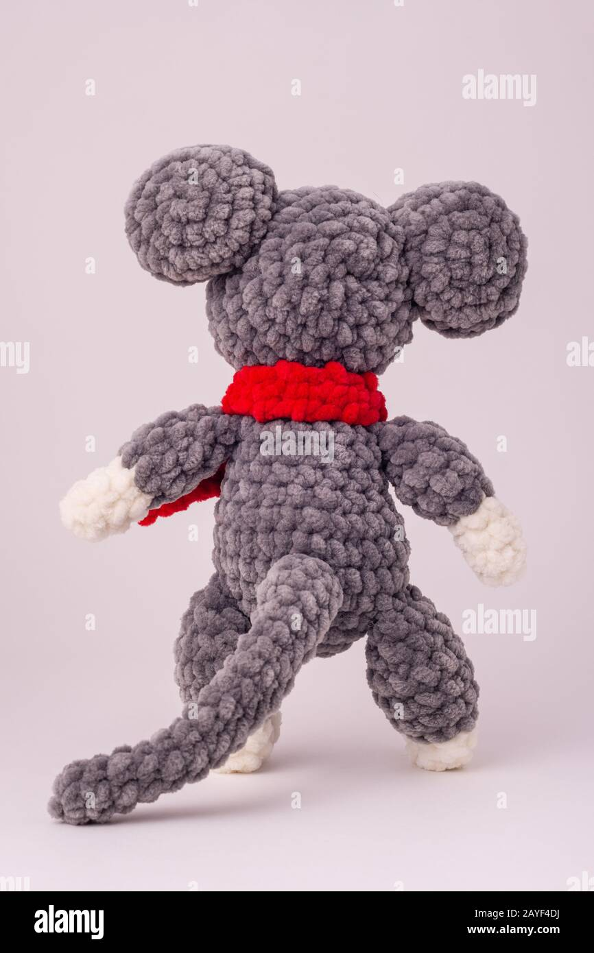 Funny knitted teddy mouse, Rear view, white background Stock Photo