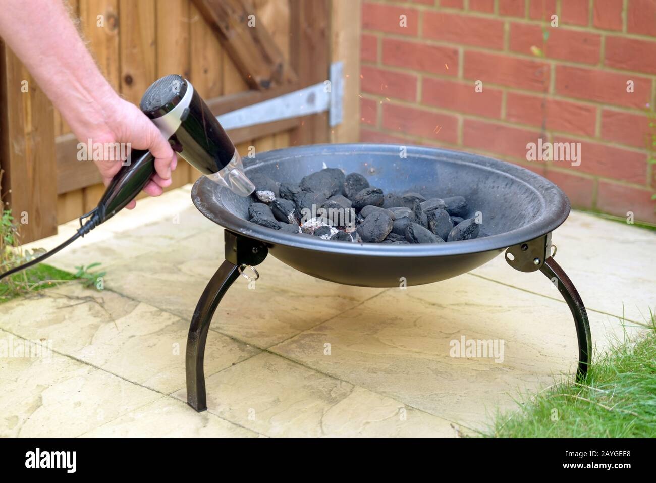 Bbq Grill Charcoal Starting Fire With Hair Dryer In Backyard In England Uk Stock Photo Alamy