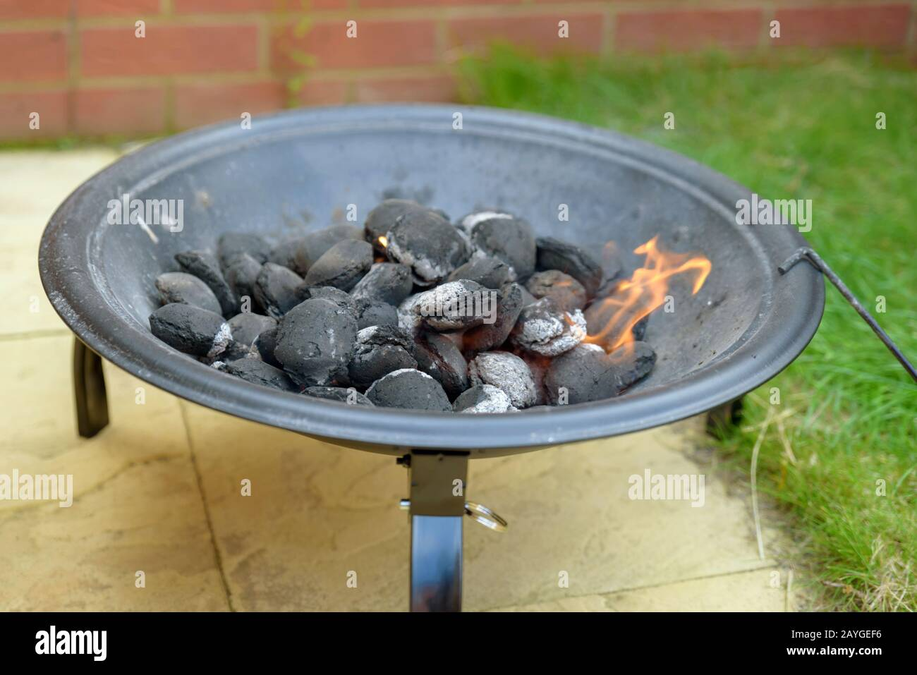 Bbq Grill Charcoal Starting Fire For Party In Backyard In England Uk Stock Photo Alamy