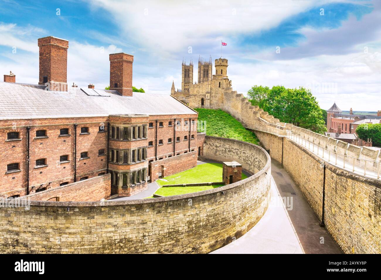 2 July 2019: Lincoln, UK - The old gaol, now a tourist attraction, from the walls of the castle. The cathedral  towers can be seen in the background. Stock Photo