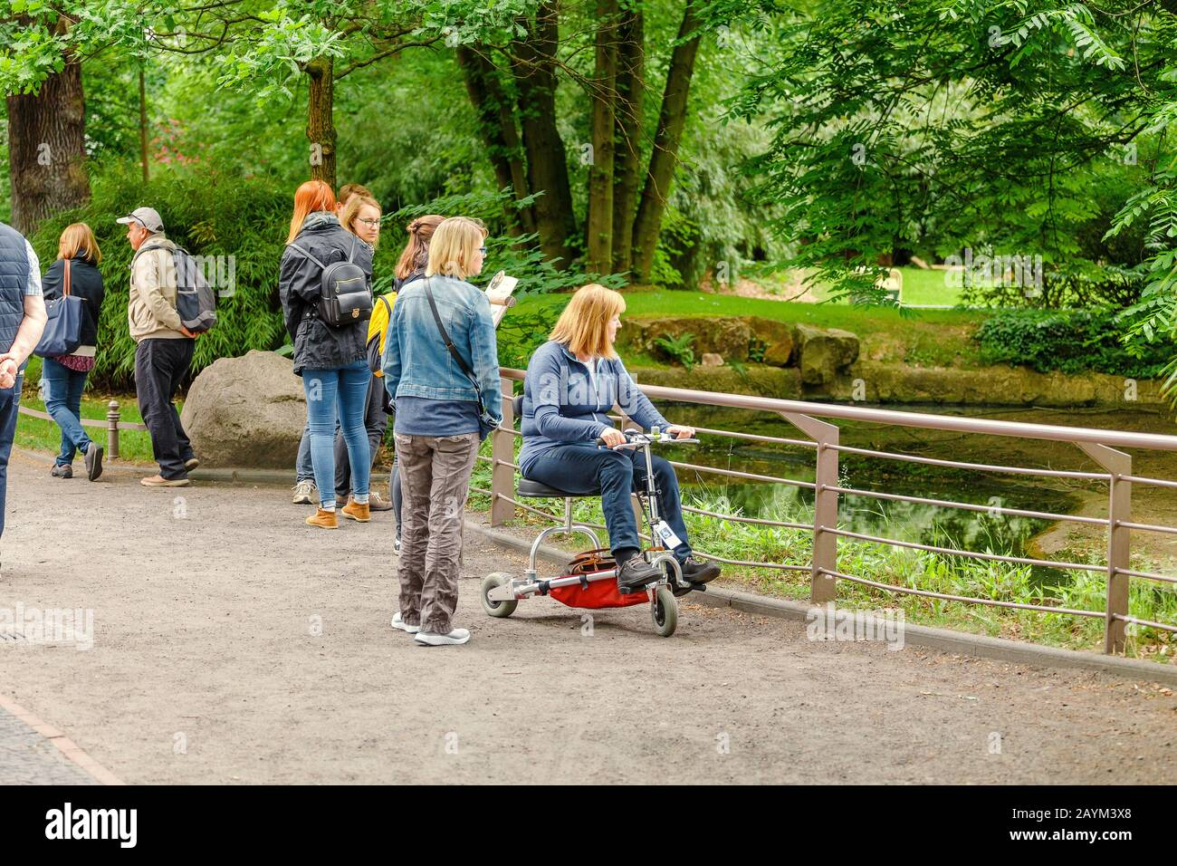 18 MAY 2018, BERLIN, GERMANY: People watching animals in the Zoo, family leisure concept Stock Photo