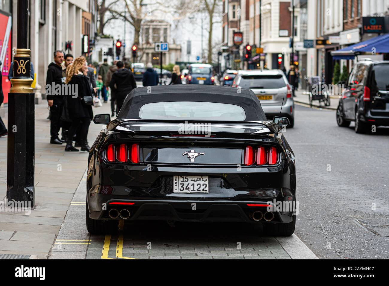 London, England, UK - January 2, 2020: a black, expensive sports muscle car parked on the edge of a city street Stock Photo