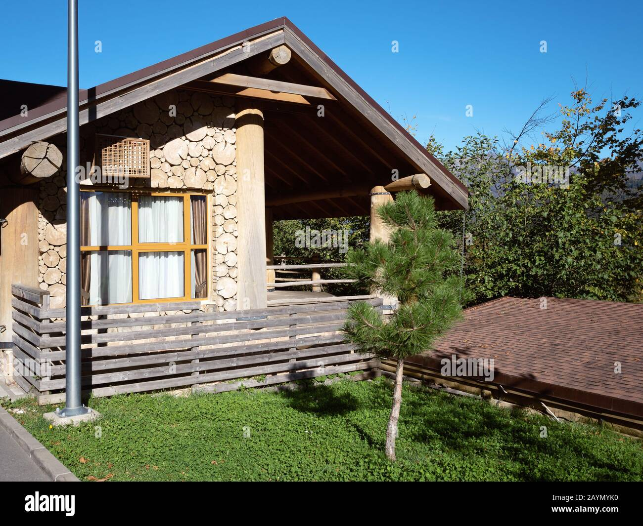 Small Wooden House With An Outdoor Terrace And Green Lawn In Front Of It Stock Photo Alamy