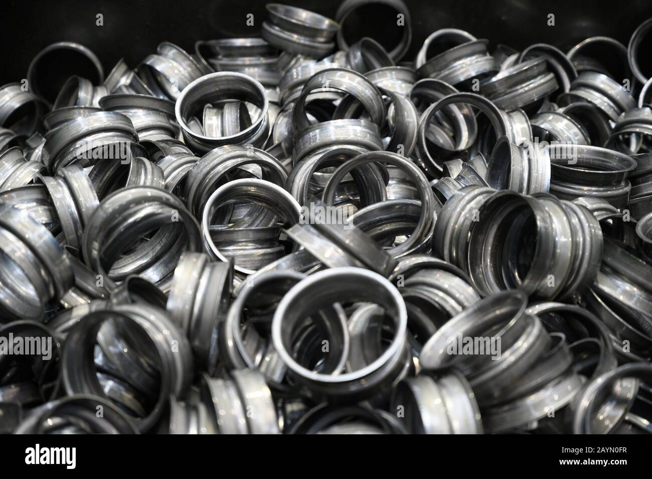 Metal pieces background. metal stamping industry. Industrial background . Stock Photo
