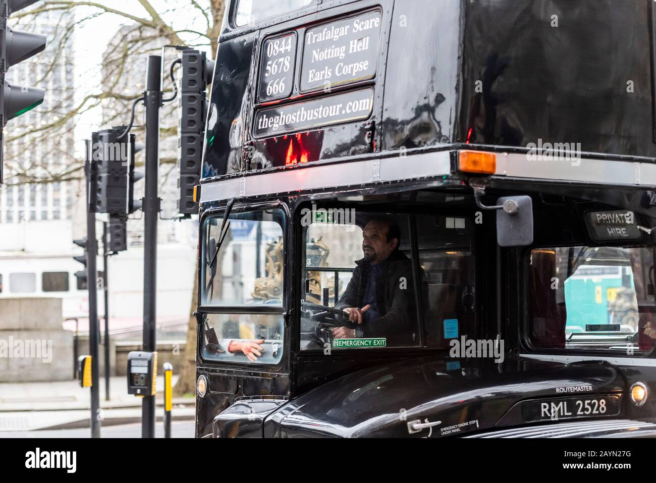 The Ghostbustour old London Routemaster bus painted black. Ghost Bus Tours retired London bus used for spooky transport around city. Dismembered arm Stock Photo