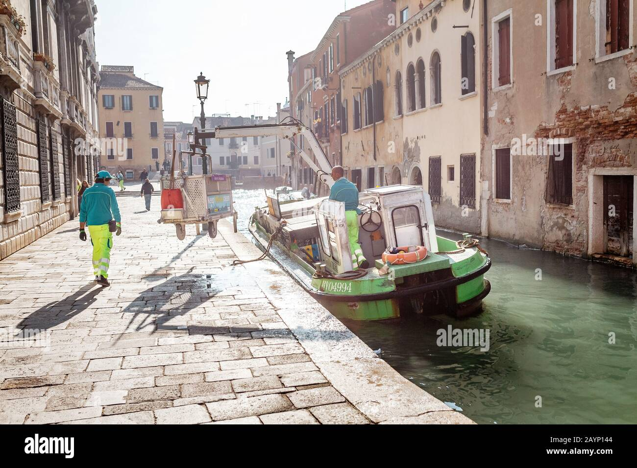 23 OCTOBER 2018, VENICE, ITALY: The boat with garbage on the venetian channel. Recycle of rubbish and trash and municipal service concept Stock Photo