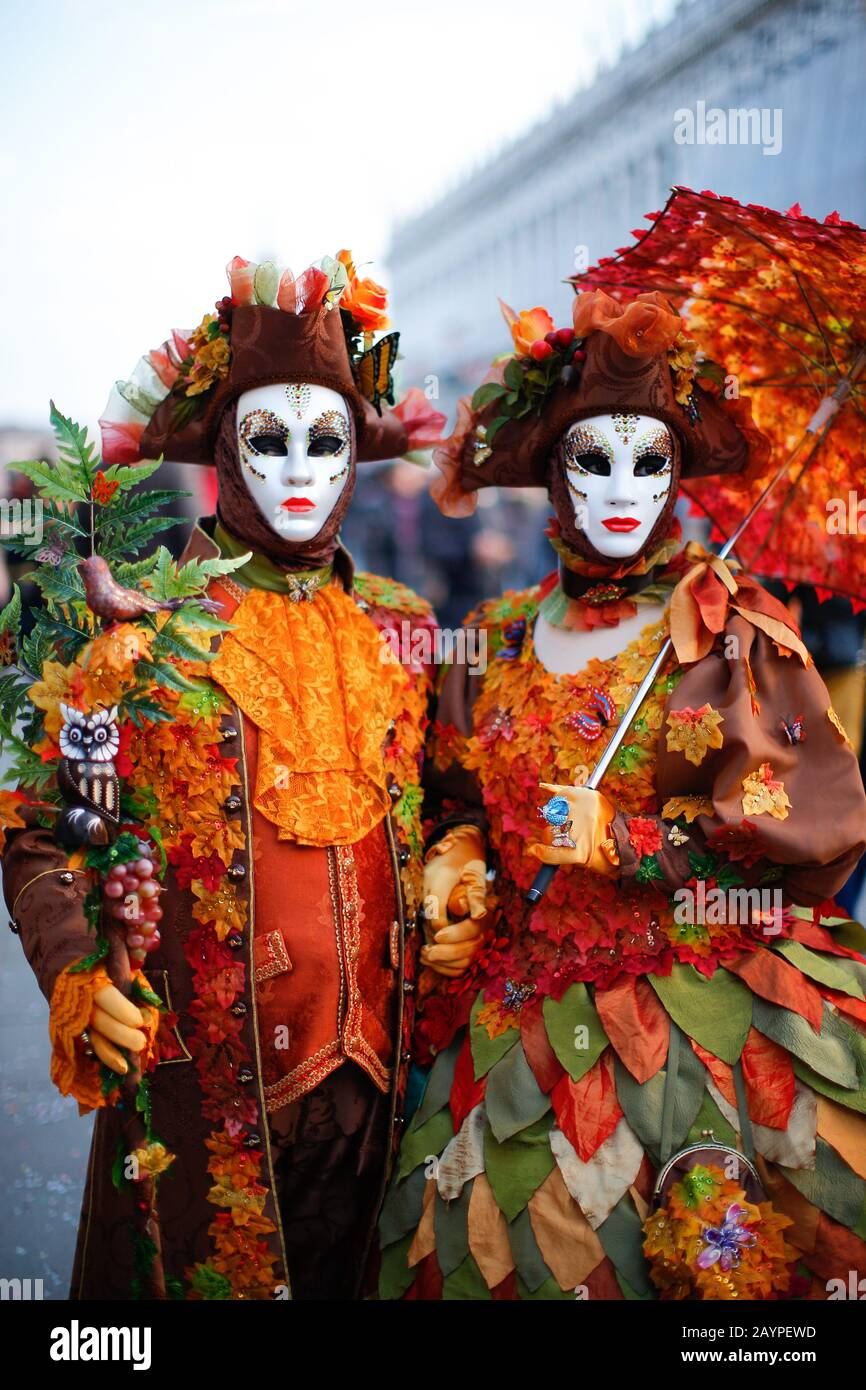 Venice, Italy - February 16, 2020: Masks participants of the 2020 Carnival celebrations St. Mark's Square. Stock Photo