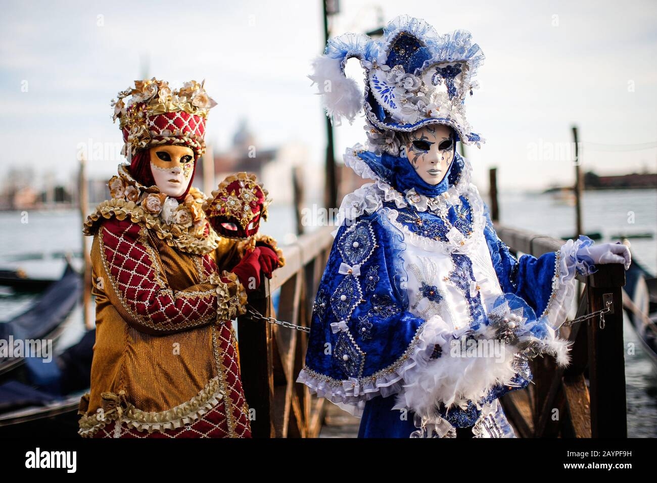 Venice, Italy - February 16, 2020: Masks participants of the 2020 Carnival celebrations St. Mark's Square. Stock Photo