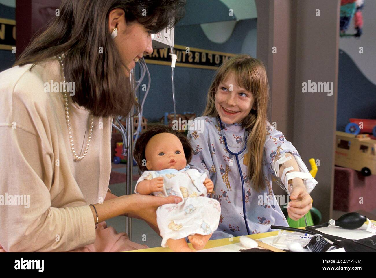 Child Life Specialist Works With Sick Child At Hospital Mr C Bob Daemmrich Stock Photo Alamy