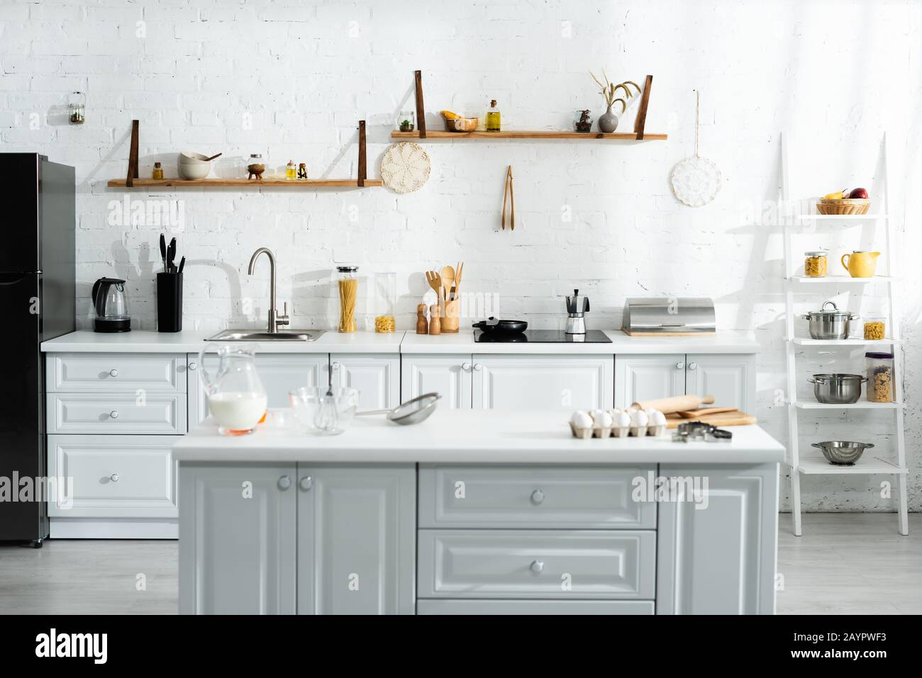 interior of kitchen with cooking utensils, food, milk and