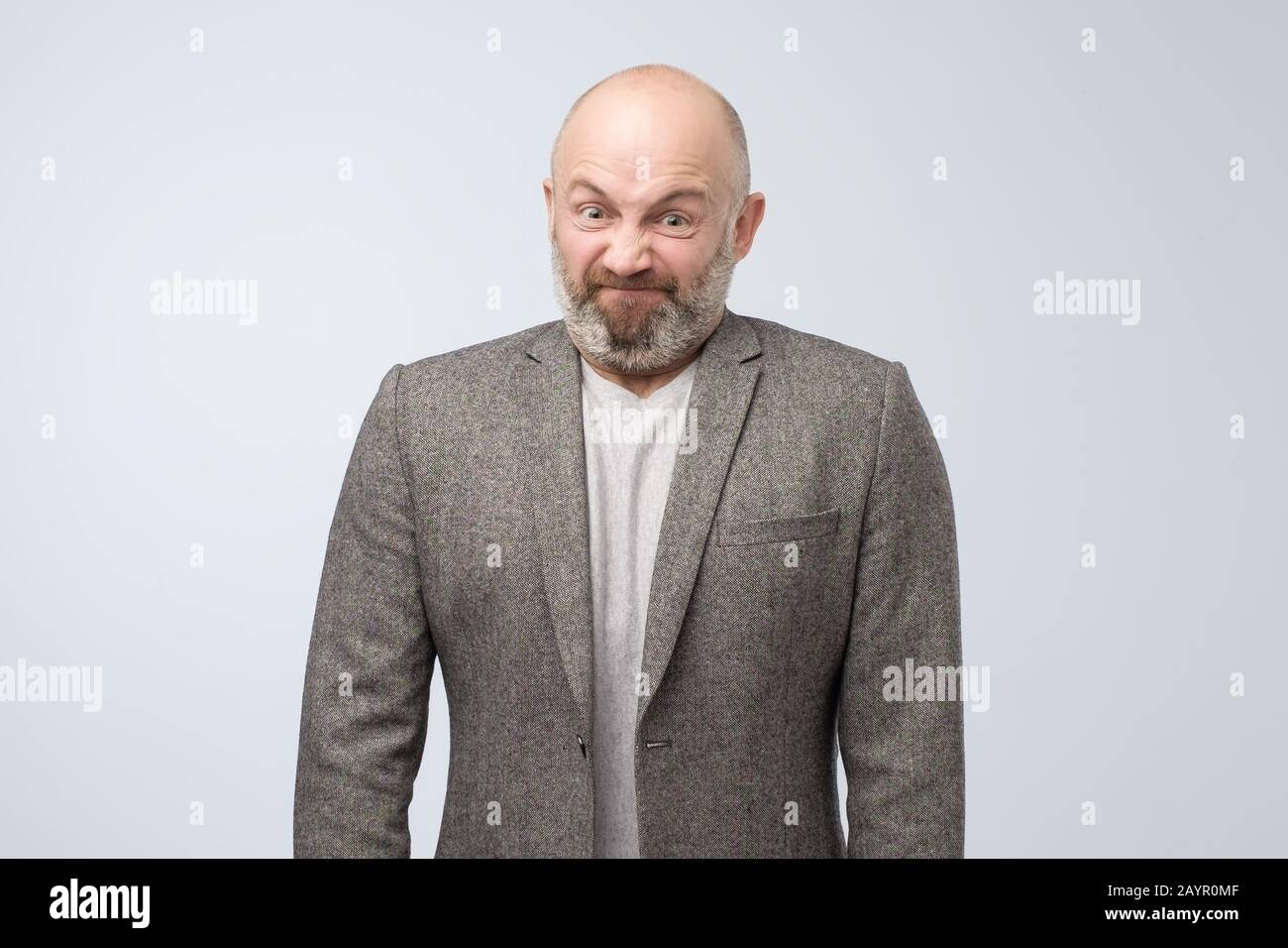 Angry caucasian man being furious losing his temper. Negative facial human emotion. Stock Photo