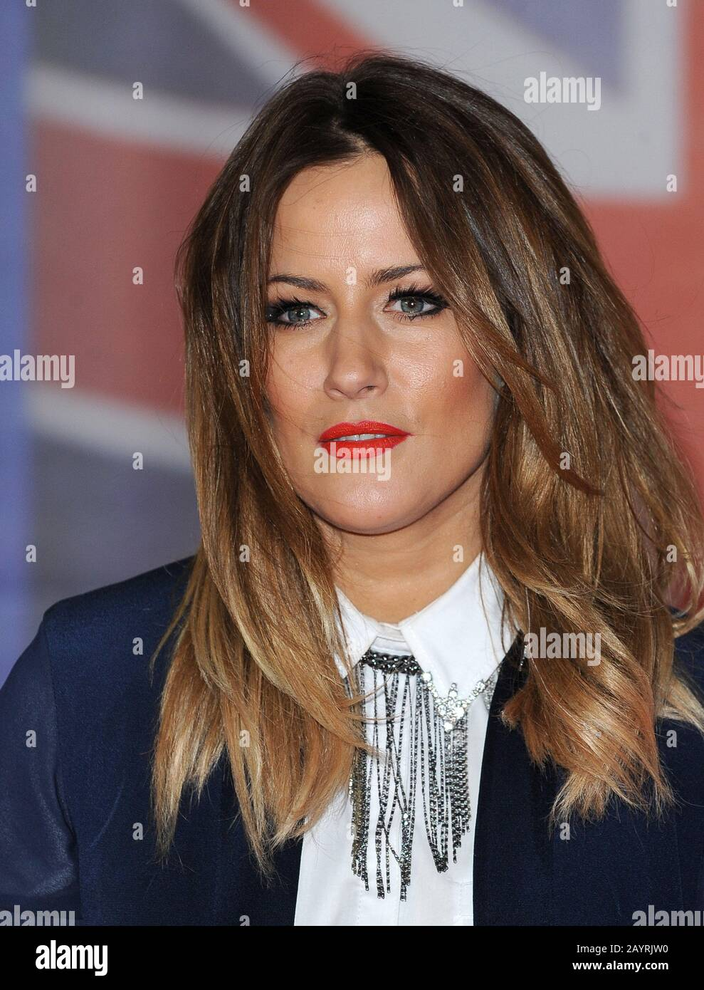 FILE: Caroline Flack found dead at 40 after committing suicide on Feb 14th. London, UK. 22nd Feb, 2012. LONDON, ENGLAND - FEBRUARY 21: Caroline Flack arrives at the BRIT Awards 2012 at O2 Arena on February 21, 2012 in London, England. Stock Photo