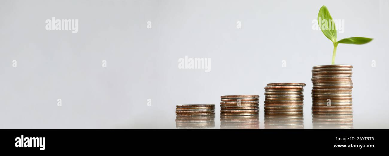 Chart tower with silver metall coin against gray background Stock Photo