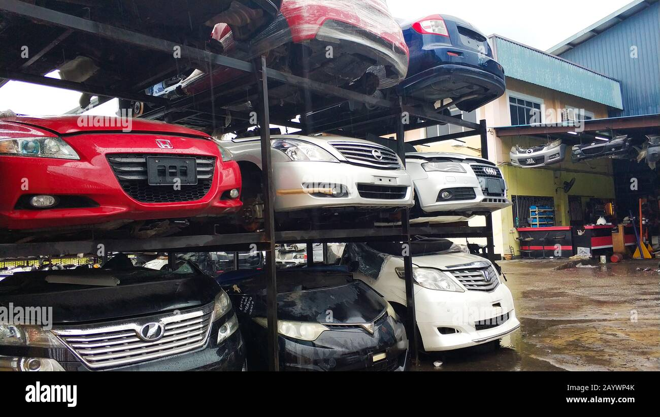 Used asian car parts store in Kuala lumpur. Shelves with disassebled cars. Stock Photo