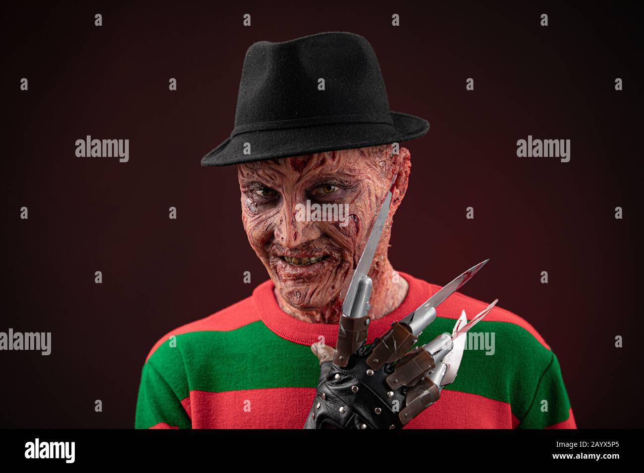 portrait of a man with a scary face and metal claws. Grimm hero for a horror movie. Freddy Krueger. 06 February 2020 Ukraine, Kyiv. make-up Stock Photo