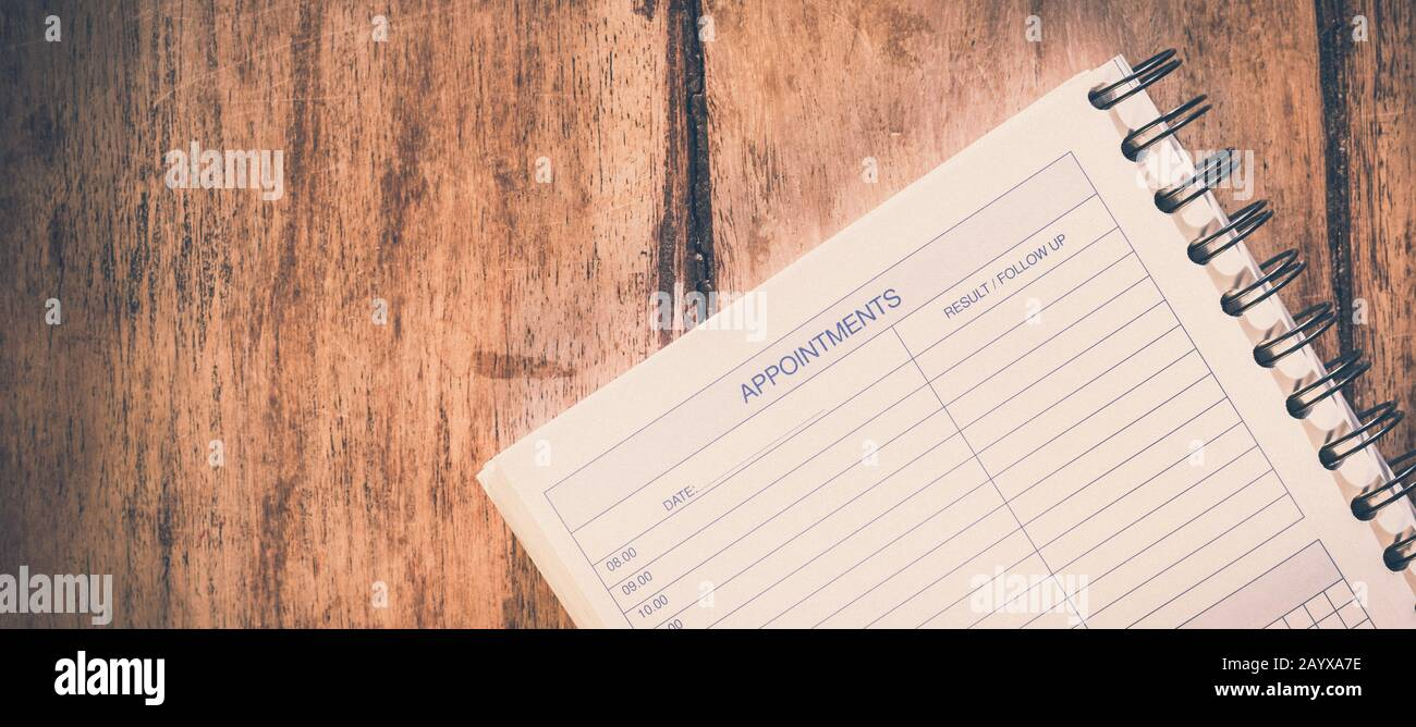 Task checklist in project management concept, pen on white paper notepad with handwritten headline as Task List and numbers listed on wood table, writ Stock Photo