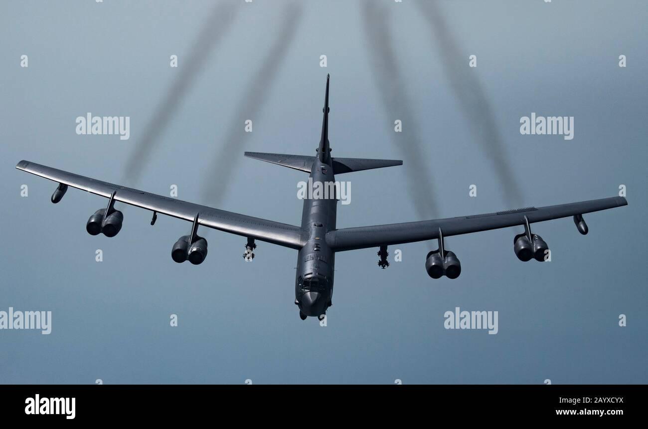 A U.S. Air Force B-52H Stratofortress strategic bomber soars across the Qatar skies near Al Udeid Air Base May 21, 2019 in Qatar. Stock Photo