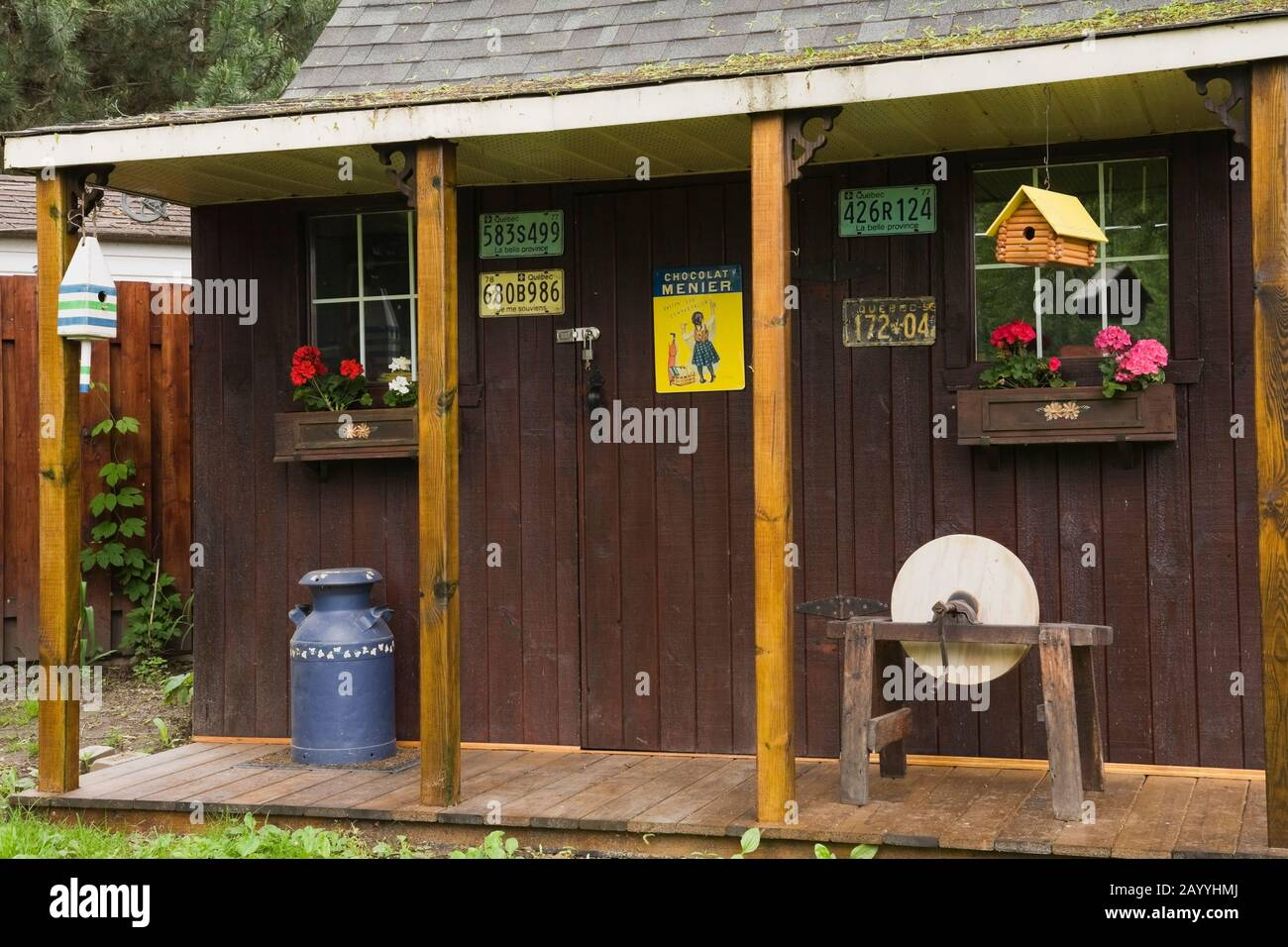 Old Wooden Tool And Storage Shed Decorated With Birdhouses And Red And Pink Geraniums In Flower Boxes In Residential Backyard Stock Photo Alamy