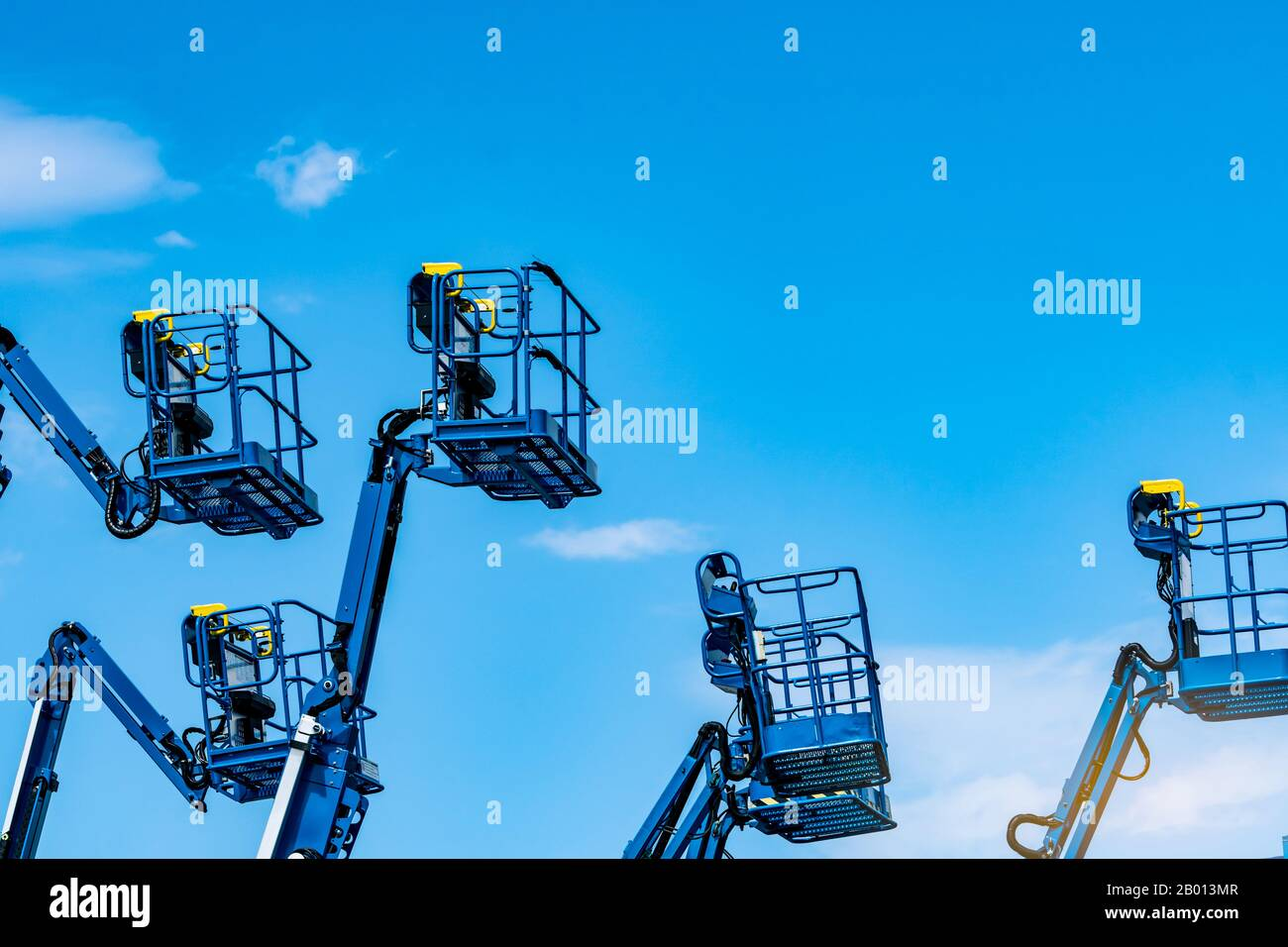 Articulated boom lift. Aerial platform lift. Telescopic boom lift against blue sky. Mobile construction crane for rent and sale. Maintenance Stock Photo