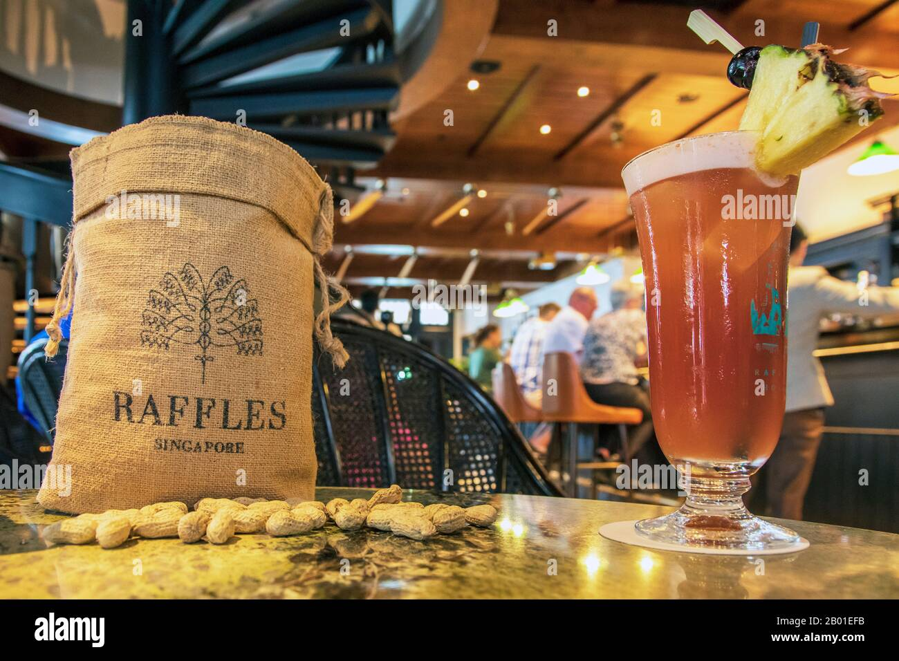 Inside The Famous Raffles Long Bar Singapore Showing A Traditional Bag Of Peanuts With The Raffles Name On It Alongside A Famous Gin Cocktail A Sin Stock Photo Alamy