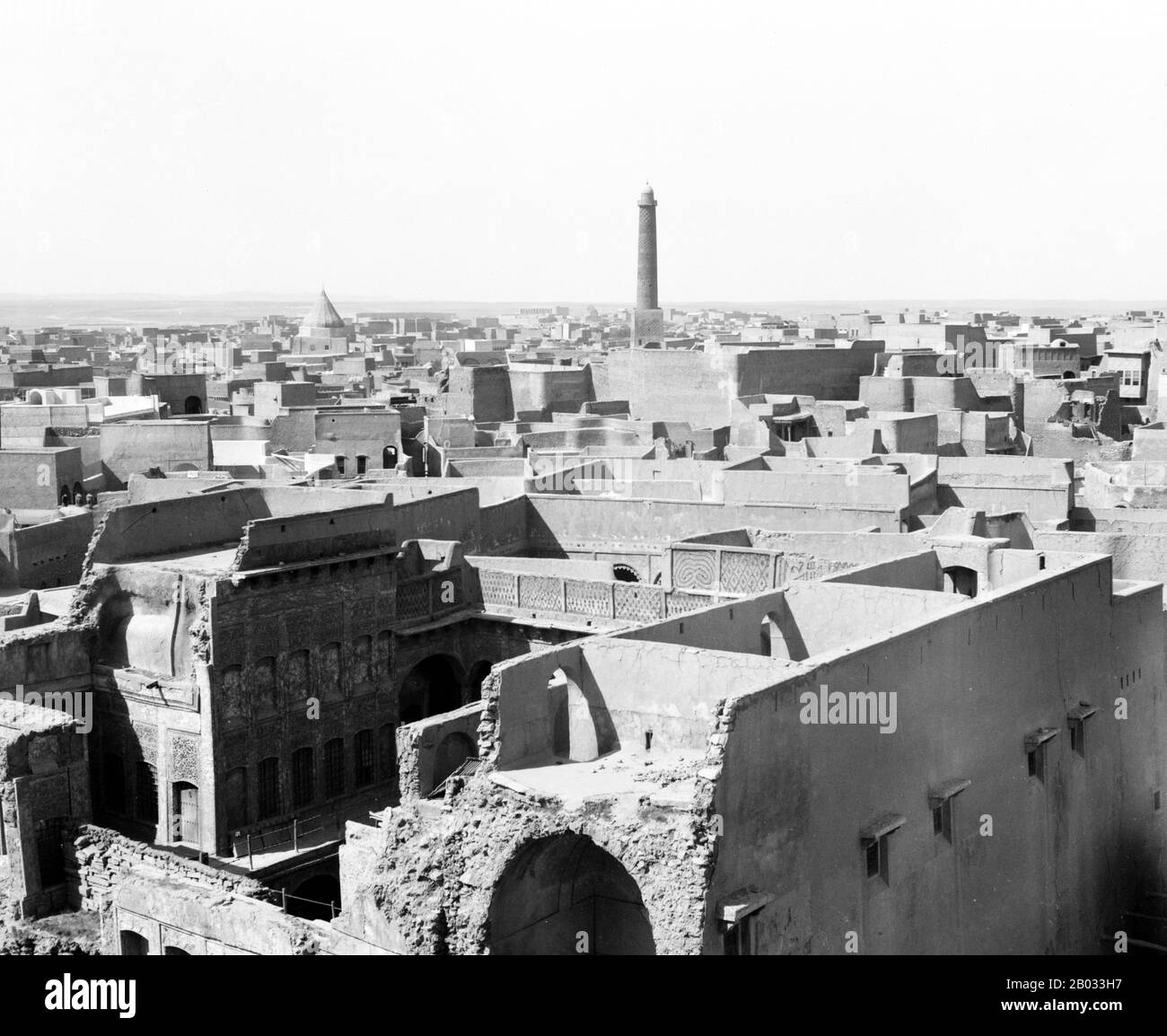 The Great Mosque of al-Nuri is a historical mosque in Mosul, Iraq famous for its leaning minaret. Tradition holds that Nur ad-Din Zangi built the mosque in 1172-73, shortly before his death. According to the chronicle of Ibn al-Athir, after Nur ad-Din took control of Mosul he ordered his nephew Fakhr al-Din to build the mosque.  The structure was targeted by ISIS militants who occupied Mosul on June 10, 2014 and previously destroyed the Tomb of Jonah. However residents of Mosul incensed with the destruction of their cultural sites protected the mosque by forming a human chain and forming a res Stock Photo