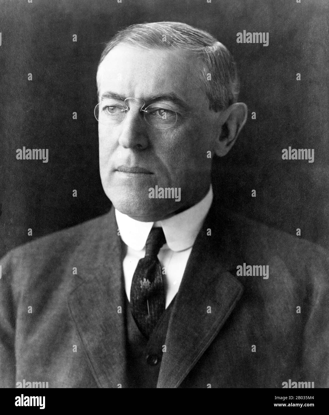 Thomas Woodrow Wilson (December 28, 1856 – February 3, 1924), better known as Woodrow Wilson, was an American politician and academic who served as the 28th President of the United States from 1913 to 1921.  In office, Wilson reintroduced the spoken State of the Union, which had been out of use since 1801. Leading the Congress, now in Democratic hands, he oversaw the passage of progressive legislative policies unparalleled until the New Deal in 1933.  A devoted Presbyterian, Wilson infused a profound sense of moralism into his internationalism, now referred to as 'Wilsonian'—a contentious posi Stock Photo