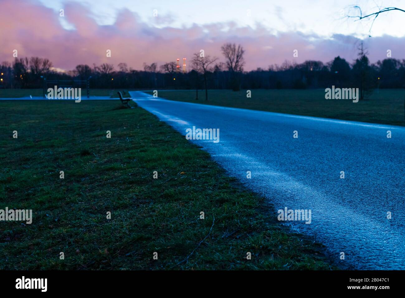 Jogging Track in a Park, background out of Focus, evening, no people Stock Photo