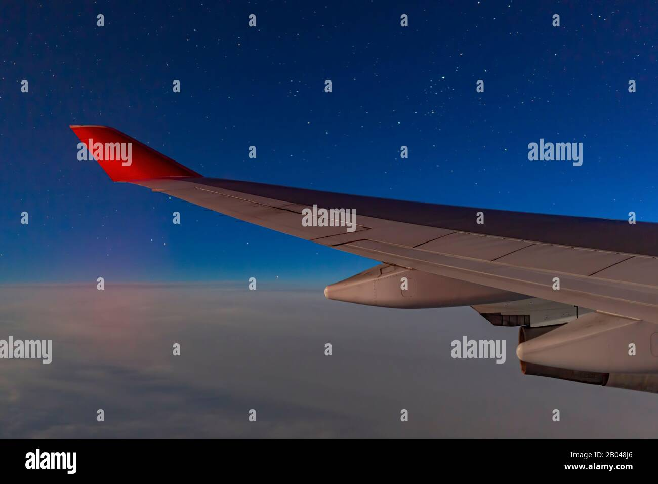 Night View With An Airplane Planewing Around Uk From An Window