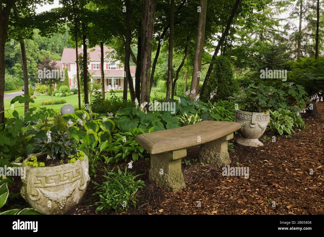 Concrete Sitting Bench And Planters On Cedar Mulch Path Bordered