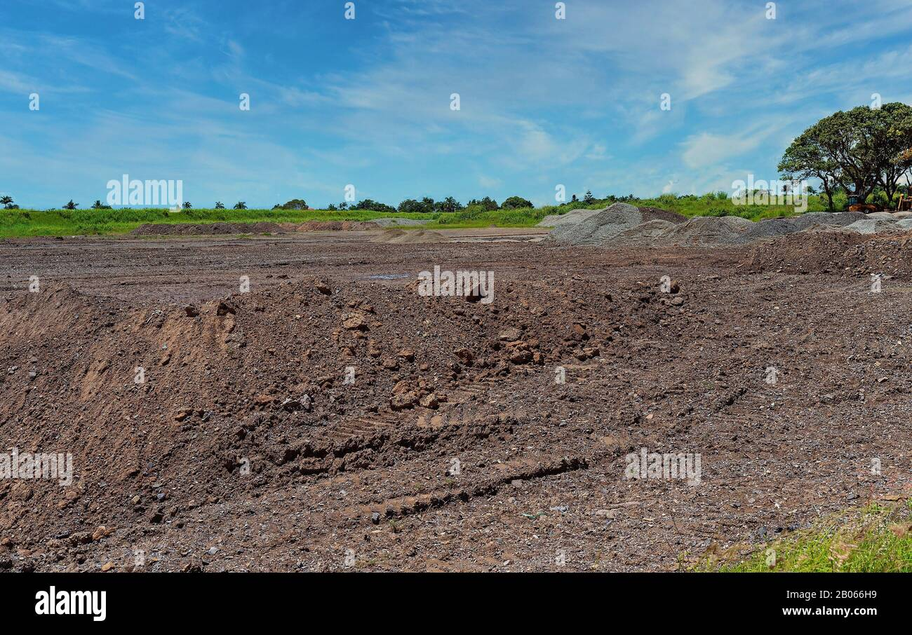 Mounds of dirt moved to create a stockpile within a housing development subdivision Stock Photo