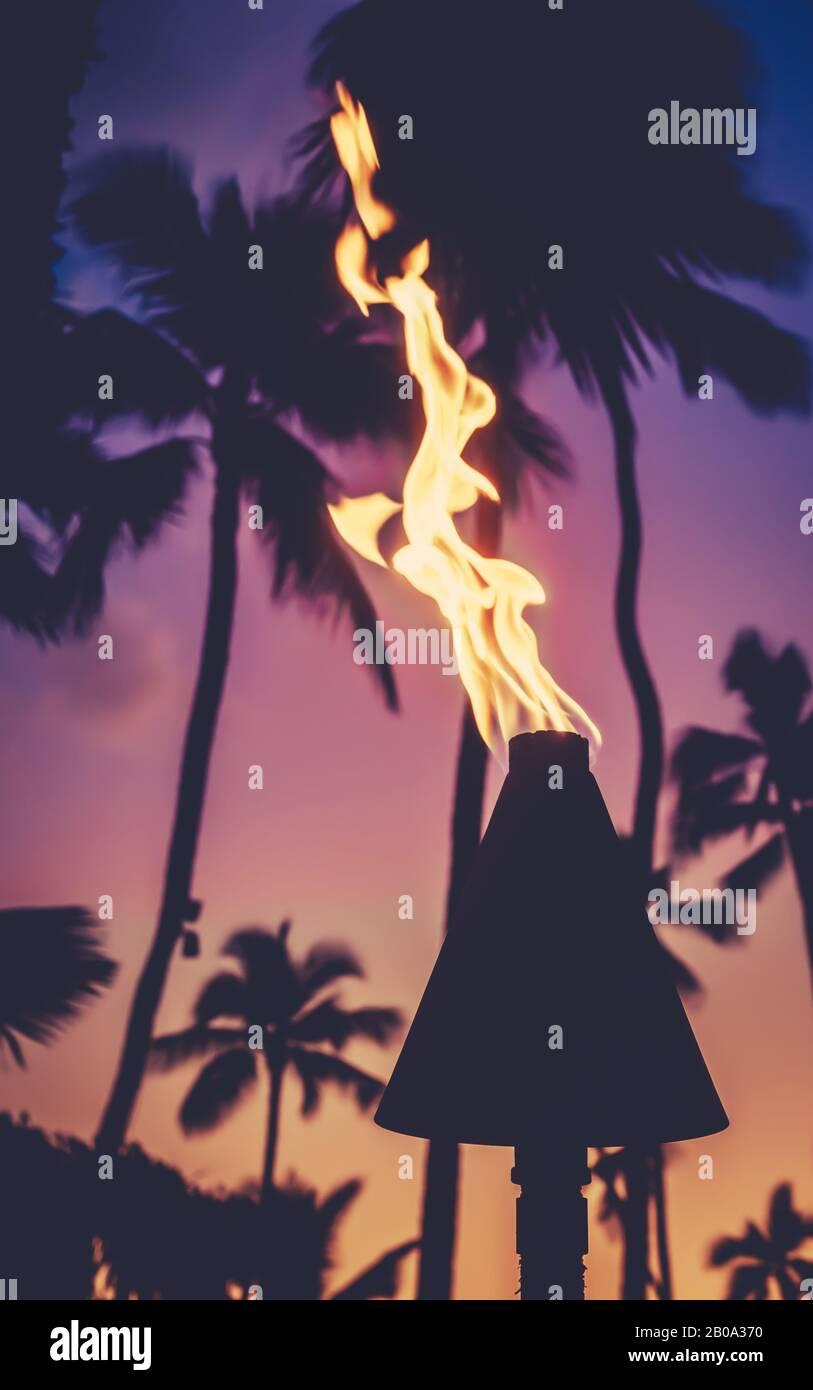 Hawaii Tiki Torches During A Beautiful Tropical Sunset Stock Photo