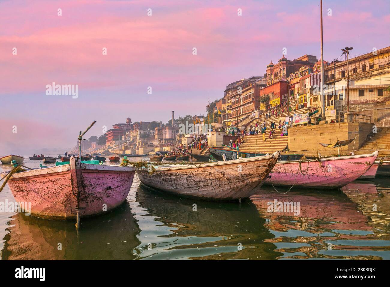 Varanasi, India - November 11, 2015. Wooden boats moored on the Ganges River, used for rowing tourists and Hindu pilgrims along the waterfront ghats. Stock Photo