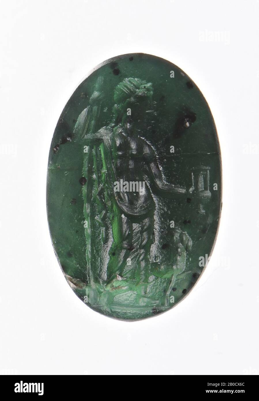 Vz: the god has a himation around his legs, a thyrsos in his right hand and a kantharos upside down in his left hand, he pours wine from the kantharos, with his feet a panther., Gem, intaglio, ringstone, plasma , Color: green, Shape: oval, Machining: front and back convex, Method: body modeling with a rounded drill, detailing with a few short rounded wheel grooves., 10 x 7 mm, D. 4 mm, 1st century n. Chr. 1-100 AD Stock Photo