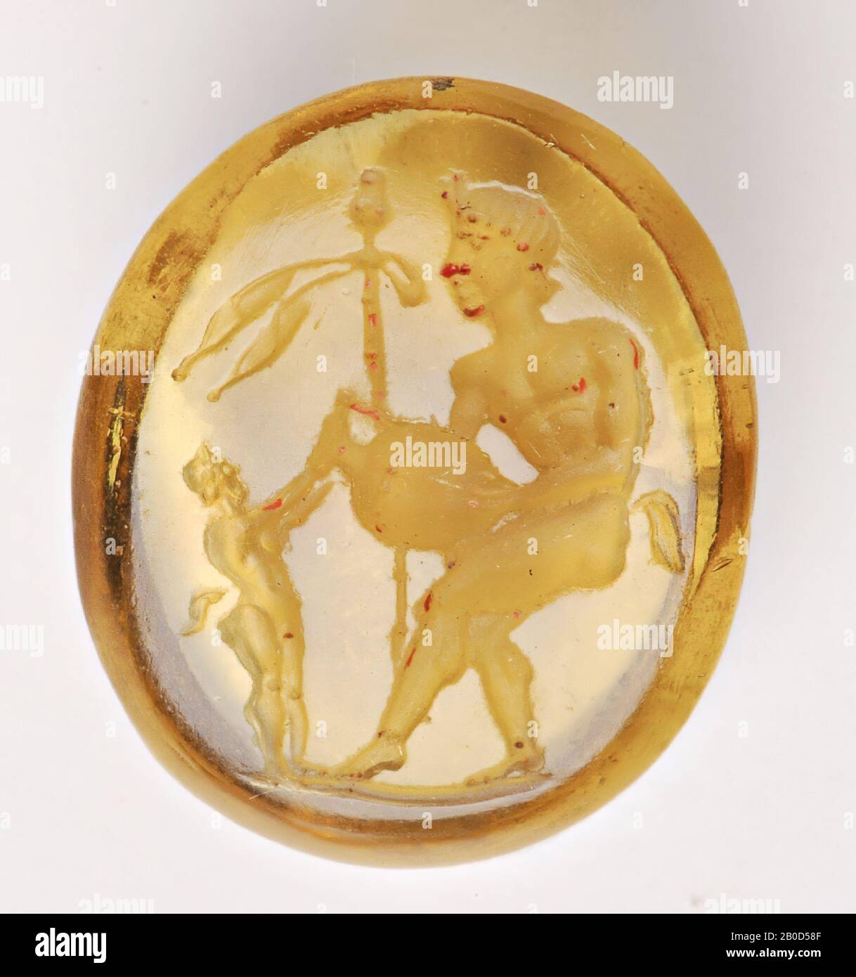 Vz: a large satyr has an amphora where the little satyr holds the neck, in the background a thyrsos., Gem, intaglio, unknown, Color: yellow, Shape: oval, Processing: edge at the back receding cut compared to front, 12 x 15 x 3.5 mm Stock Photo