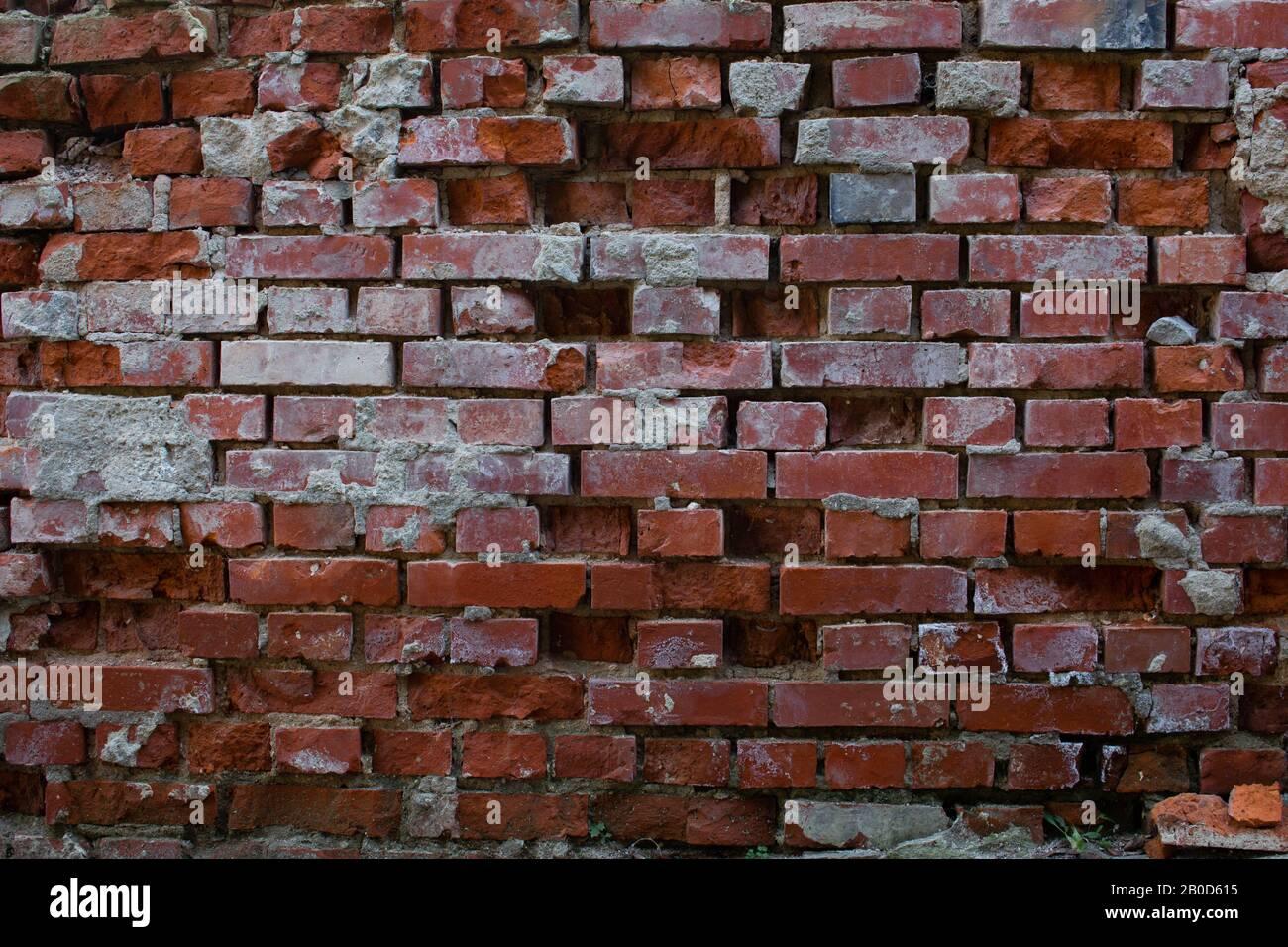 Old Broken Damaged And Corroded Brick Wall With Broken Bricks