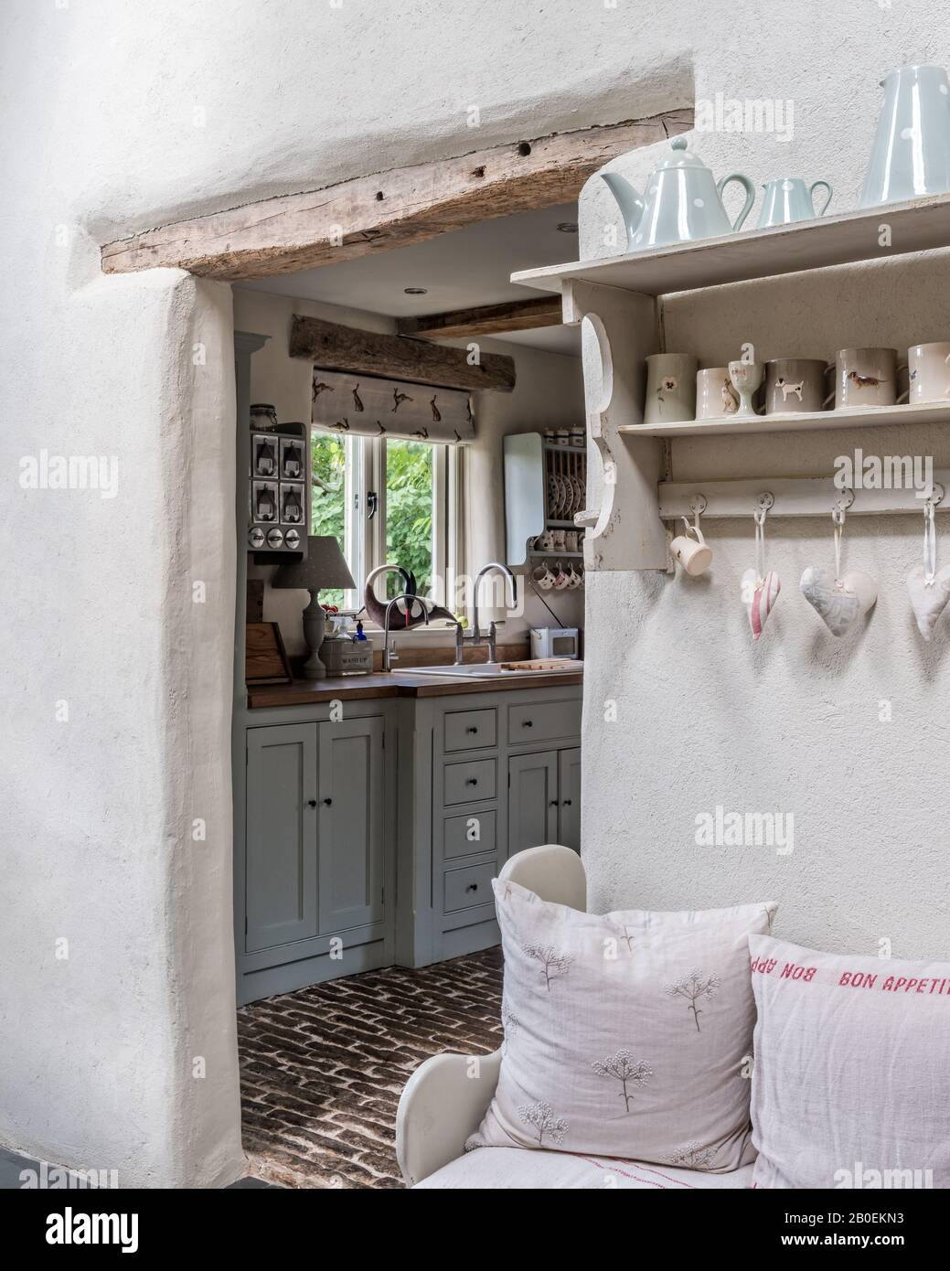 Hearts Hang On Wall Mounted Shelf With View To Kitchen Stock Photo Alamy