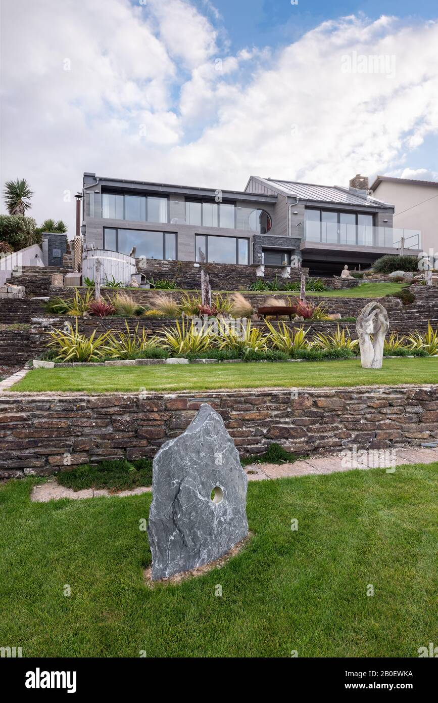 Statues in terraced garden of renovated 1960s property in Fistral, Newquay Stock Photo
