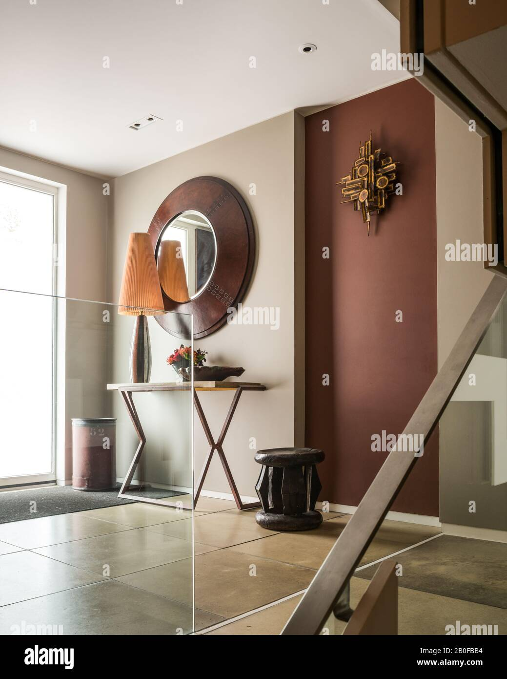 Large mirror above table in hallway of modern Wset London apartment. Stock Photo