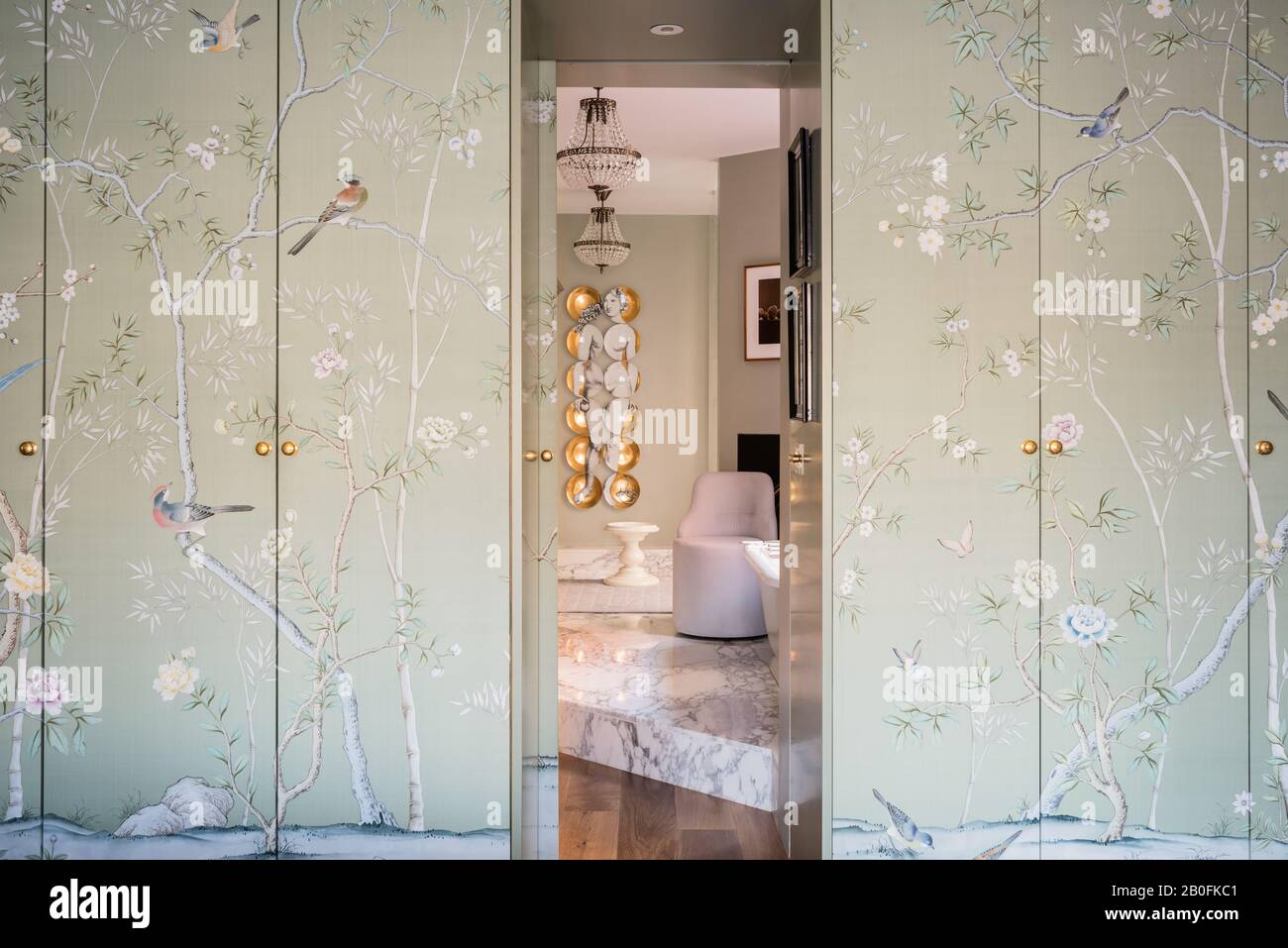 Chinoiserie wall paper covering wardrobe doors. Stock Photo
