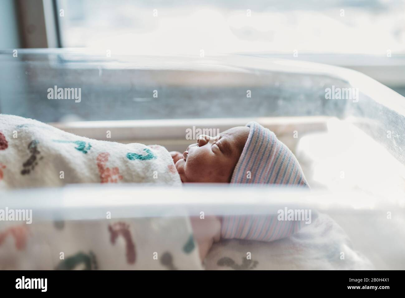 Side view of newborn boy profile with hat in hospital Stock Photo