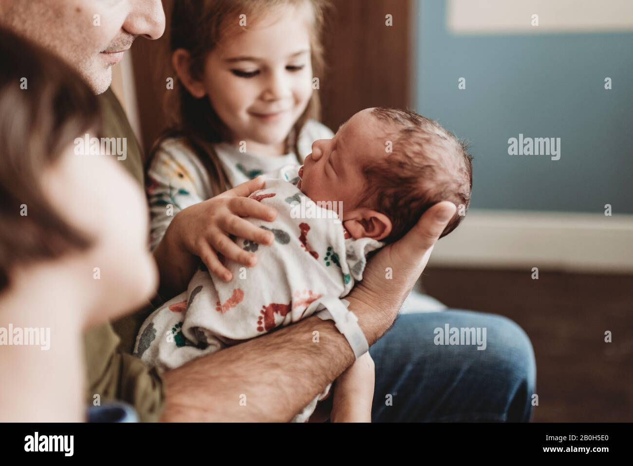 Close up side view of newborn boy and family in hospital with family Stock Photo