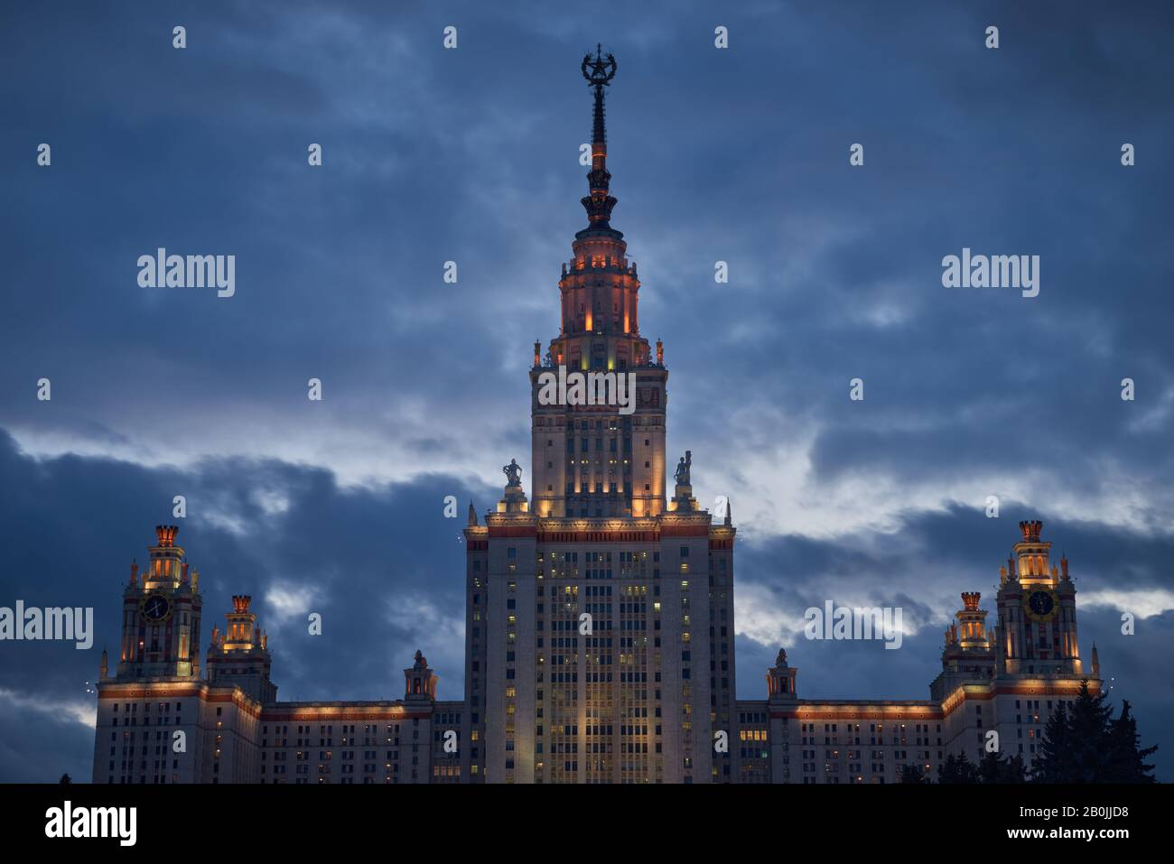 Lights are lit in the windows of Moscow State University at dusk Stock Photo