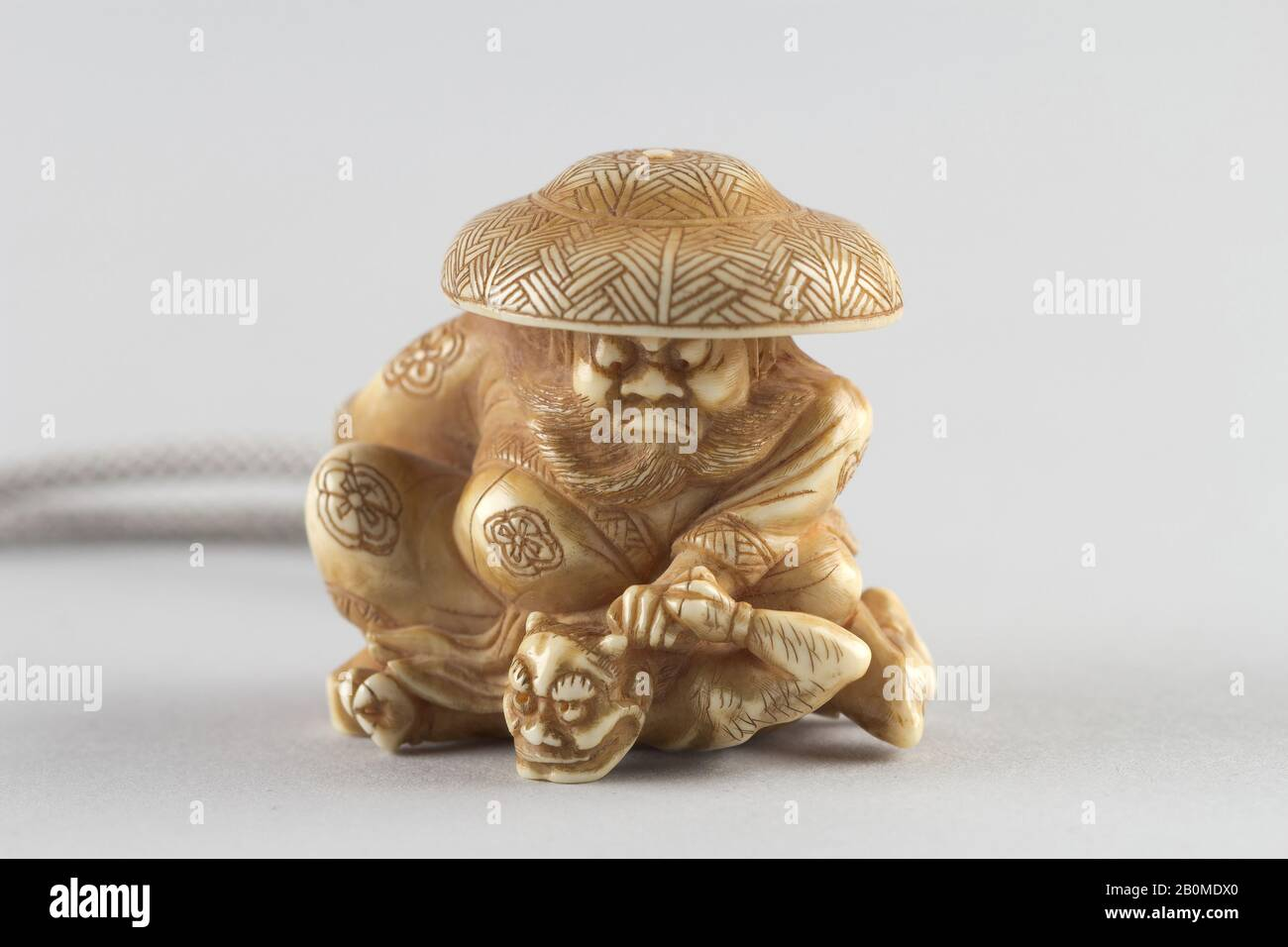 Japanese ivory color bone  netsuke Buddhist Boy Sits with Prayer Beads