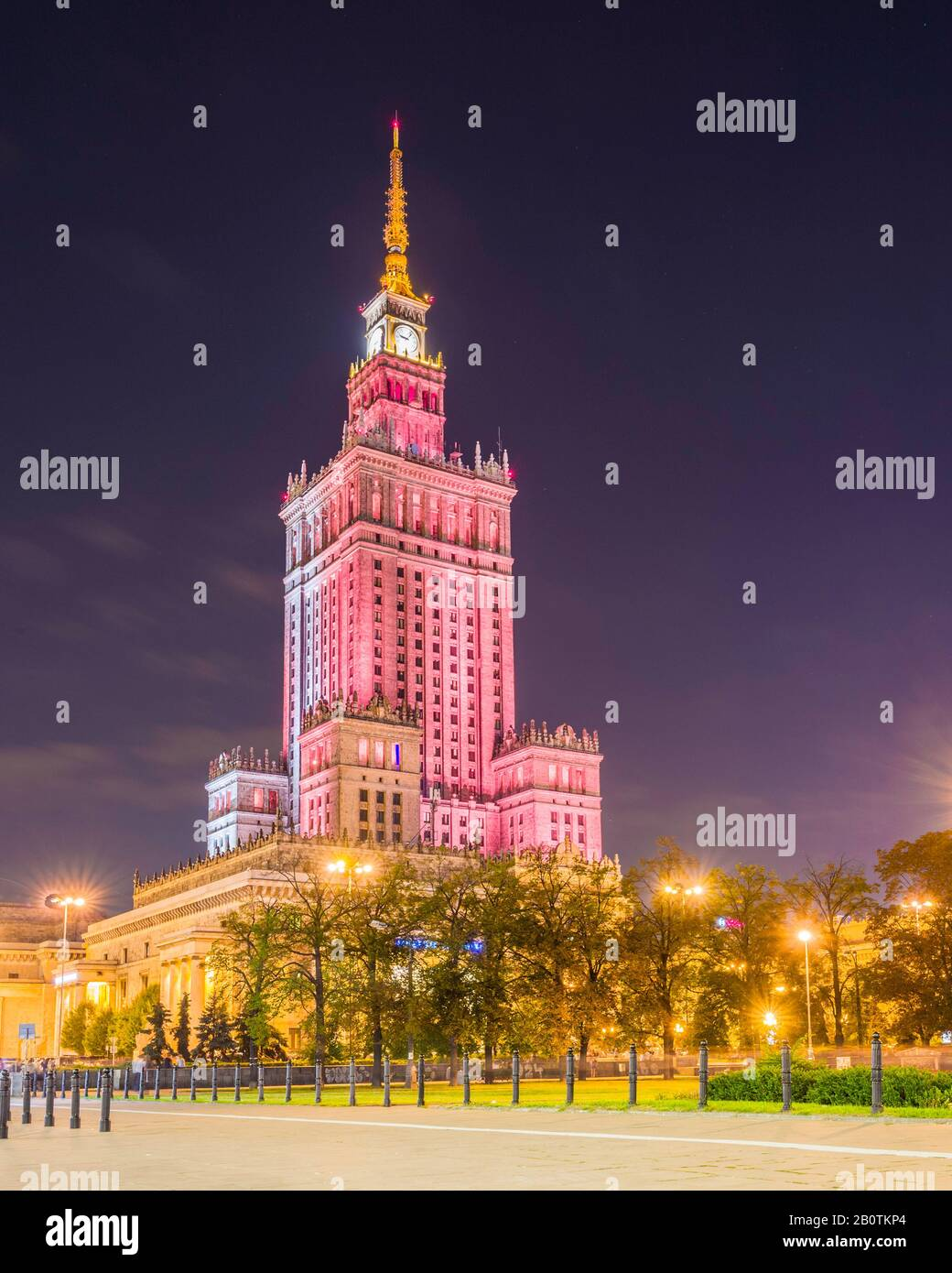 Illuminated at night, the Palace of Culture and Science (1955) is a Soviet designed skyscraper in central Warsaw, Poland. Stock Photo