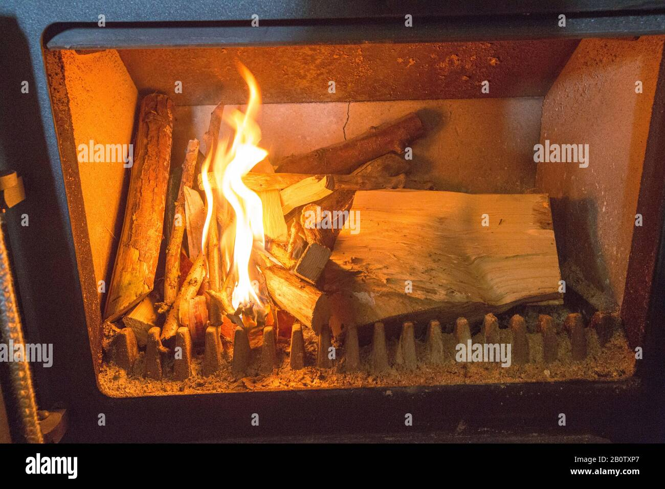 Piicture Shows Wood On Fire In A Wood Burning Stove Owners Of