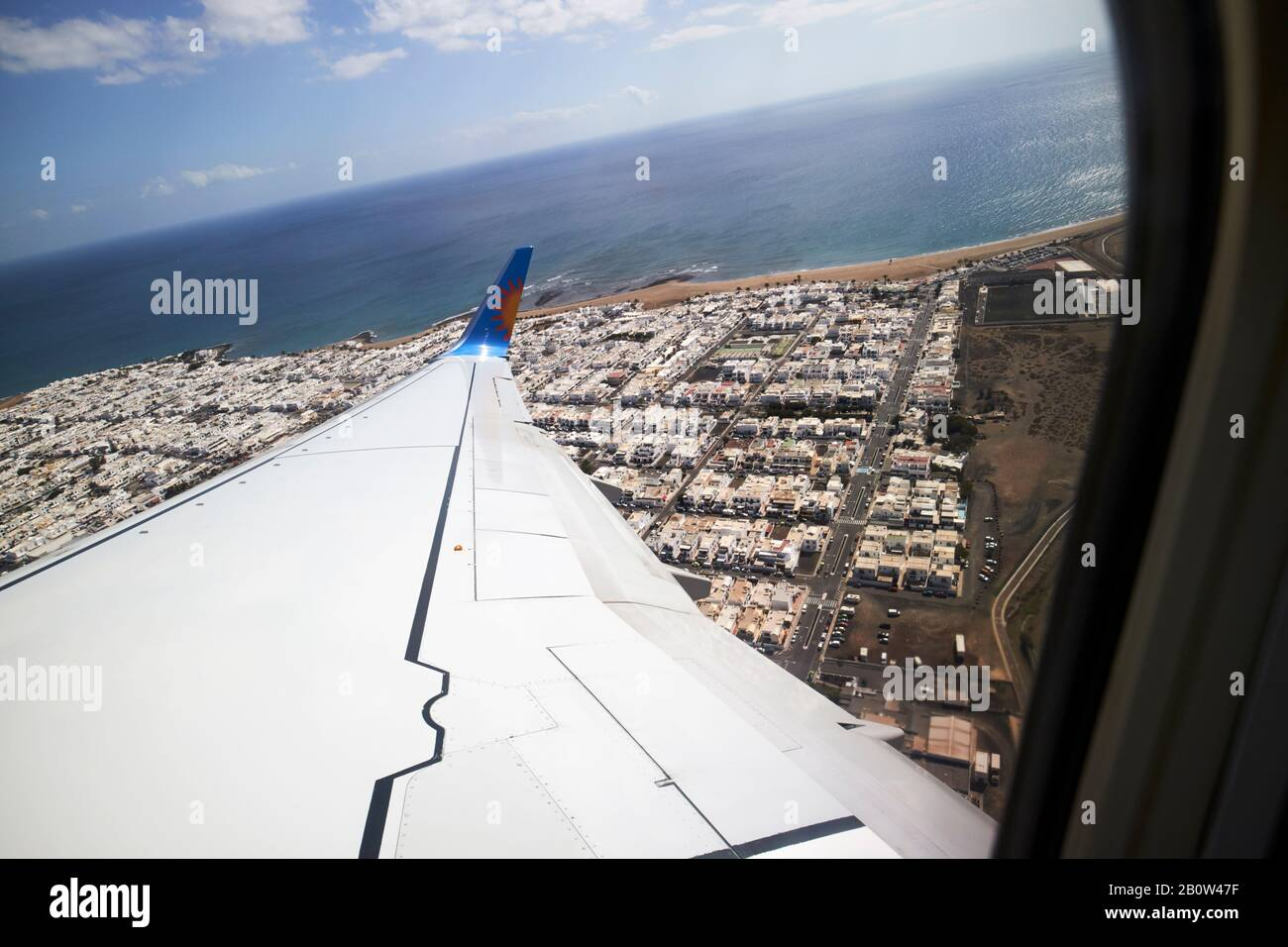 looking out of window of jet2 aircraft taking off from arricife airport in lanzarote flying over densely packed playa honda Stock Photo