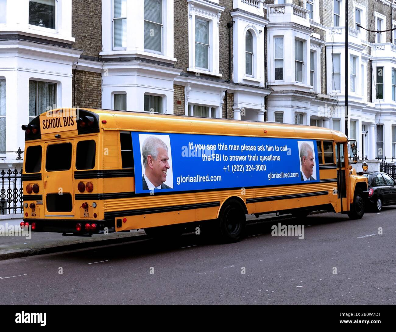 London, UK. 21st Feb, 2020. US school bus with poster urging the public to 'get Prince Andrew to call the FBI' if they see the Duke of York, tours London arranged by Jeffrey Epstein victims' lawyer. Credit: Brian Minkoff/Alamy Live News Stock Photo