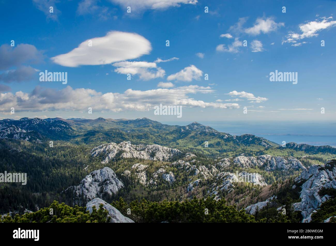 View of mountains, sky and sea in Croatia, Northern Velebit National Park. Scenic mountain landscape. Rocky mountains picturesque nature Stock Photo